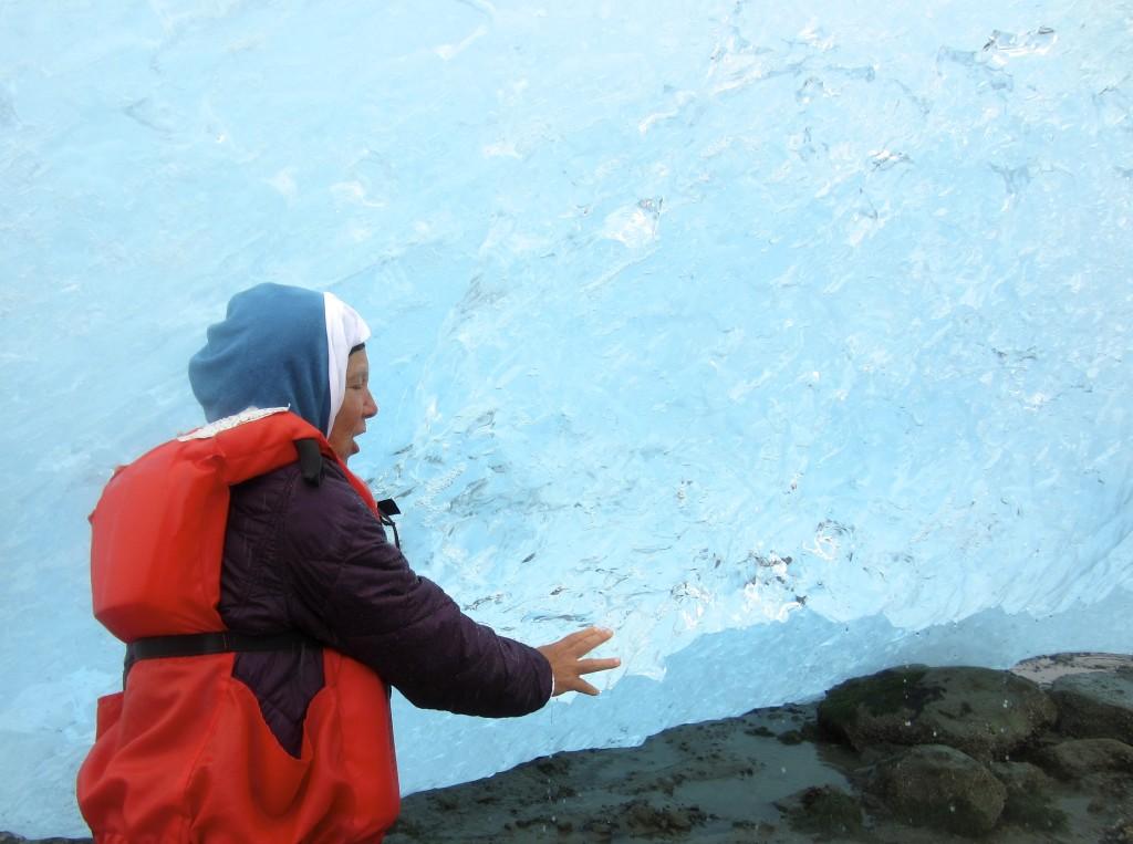 Page examines an iceberg