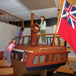 Jaye, Violet and Nile enjoy playing on an early ship
