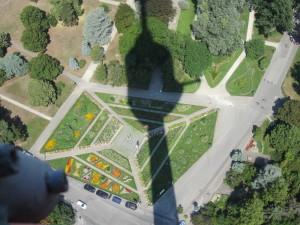 Shadow of Danube Tower on garden below